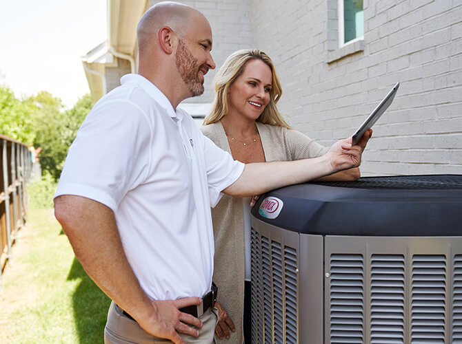 Couple looking at a SunSource AC